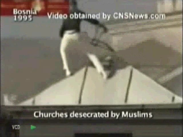 The Above Picture Shows Muslim Man Breaking And Removing Cross From Roof Of A Church Later Muslims Burnt Entire